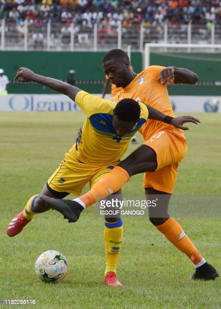 Ivory Coast's Nicolas Pepe vies for the ball with Rwanda's Djihad Bizimana during the 2019 African Cup of Nations Group H qualification football...
