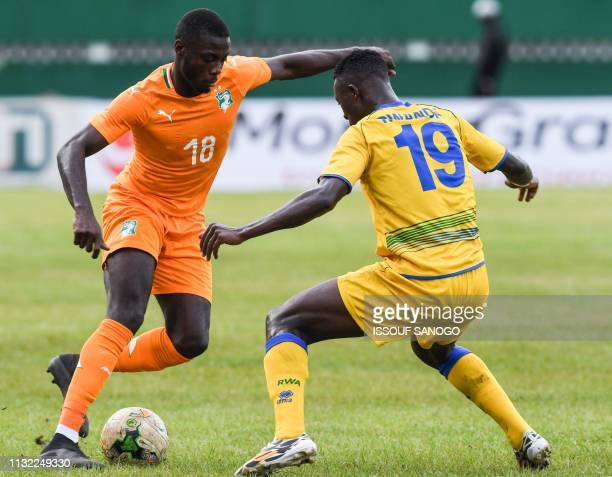 Ivory Coast's Nicolas Pepe vies for the ball with Rwanda's Emmaunel Imanishimwe during the 2019 African Cup of Nations Group H qualification football...