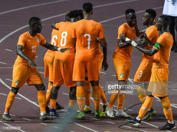 Ivory Coast's players celebrate a goal during the 2019 African Cup of Nations Group H qualification football match between Ivory Coast and Rwanda on...