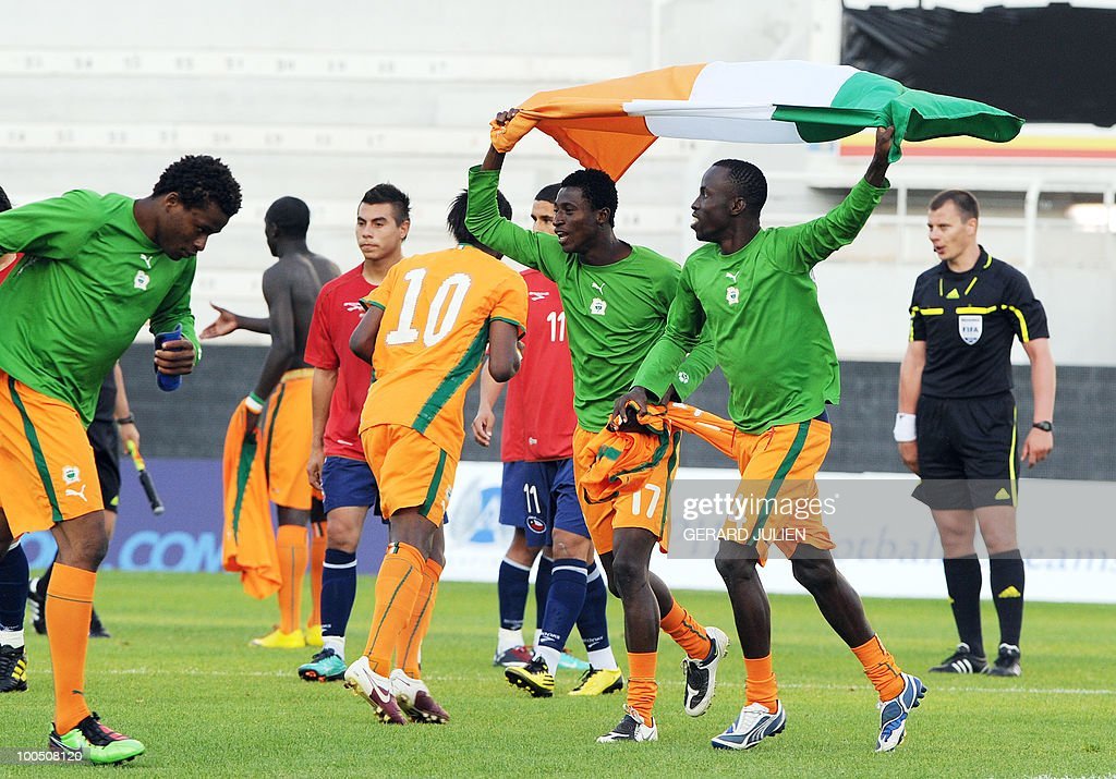 Ivory Coast's players celebrate after their victory at the end of their semi-final of the Under 21 International Tournament football match Chile versus Ivory Coast on May 25, 2010 at the Mayol stadium in Toulon, southern France. This is the 38th edition of the event.