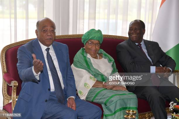 Ivory Coast's President Alassane Ouattara and former Liberian president Ellen Johnson Sirleaf listen to Sudanese telecom tycoon Mo Ibrahim founder of...