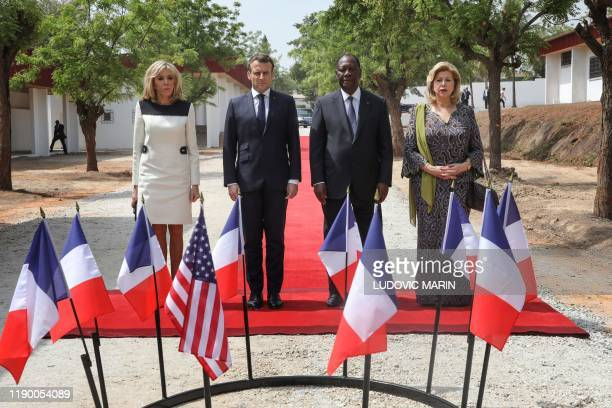 Ivory Coast's President Alassane Ouattara and his wife Dominique Ouattara stand with French President Emmanuel Macron and his wife Brigitte Macron...