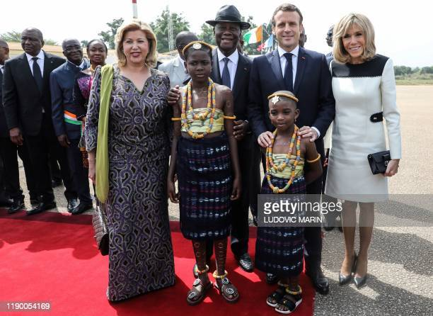 Ivory Coast's President Alassane Ouattara and his wife Dominique Ouattara pose with French President Emmanuel Macron and his wife Brigitte Macron...