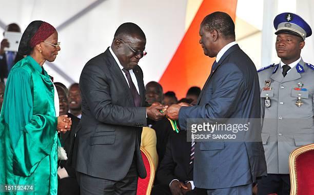 Ivory Coast's President Alassane Ouattara by Ramata Bakayoko president of the University Council delivers symbolic keys of newly baptised Felix...