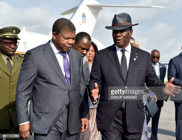 Ivory Coast's President Alassane Ouattara welcomes Angola's President Joao Lourenco upon his arrival at the Felix HouphouetBoigny airport in Abidjan...