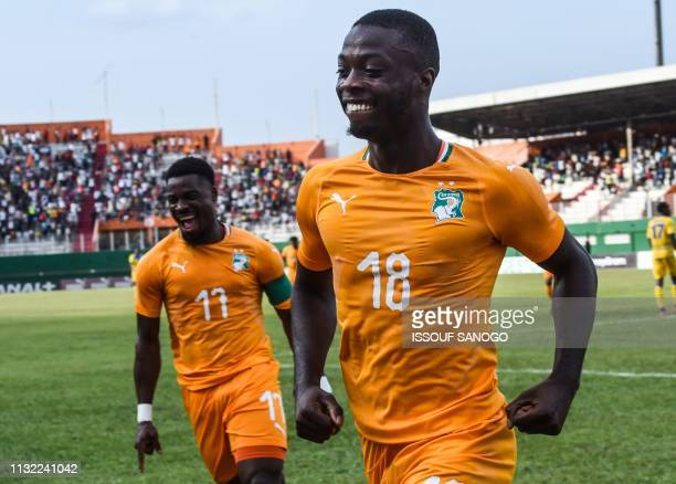 Ivory Coast's Serge Aurier and Nicolas Pepe celebrate a goal during the 2019 African Cup of Nations Group H qualification football match between...