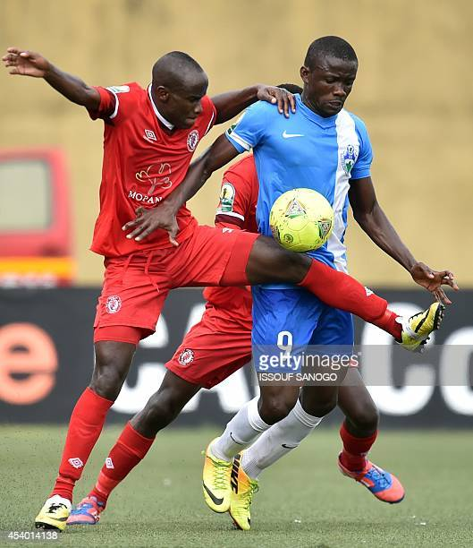 Ivory Coast's Sewe San Pedro player Hermann Kouao vies with Zambia' Nkana FC Donashano Malama during the CAF Conferderation Cup qualification match...