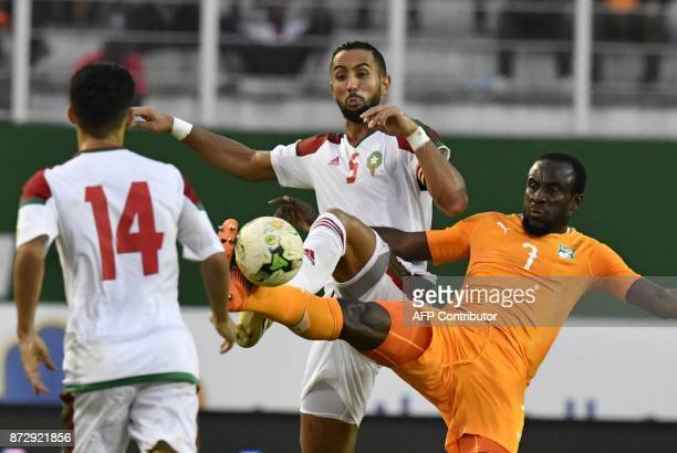 Ivory Coast's Seydou Doumbia vies with Morocco's Medhi El Moutaqui Benatia and Mbark Boussoufa during the FIFA World Cup 2018 Africa Group C...