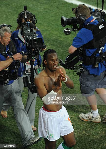 Ivory Coast's striker Didier Drogba applauds supporters after the Group G first round 2010 World Cup football match Ivory Coast versus North Korea on...