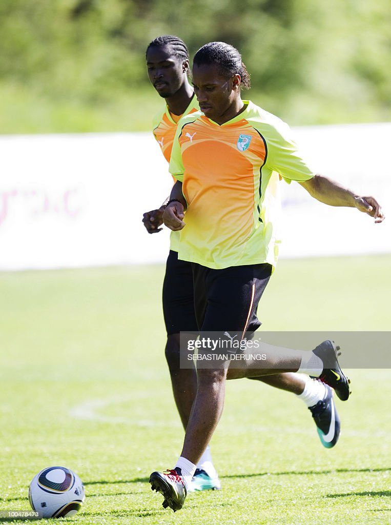 Ivory Coast's striker Didier Drogba (C/foreground) warms up during a practice session on May 24, 2010 in Saanen, Switzerland, ahead of the FIFA World Cup 2010 finals in South Africa.