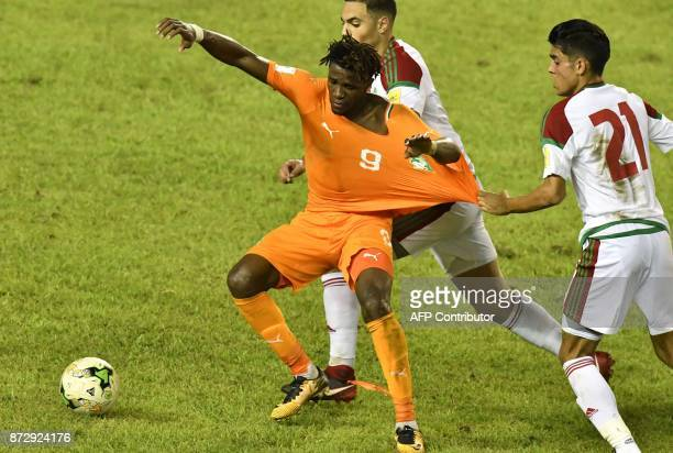 Ivory Coast's Wilfred Zaha vies with Morocco's players at the Felix HouphouetBoigny stadium in Abidjan on November 11 during the FIFA World Cup 2018...