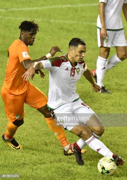 Ivory Coast's Wilfred Zaha vies with Morocco's Sofyan Amrabat at the Felix HouphouetBoigny stadium in Abidjan on November 11 during the FIFA World...