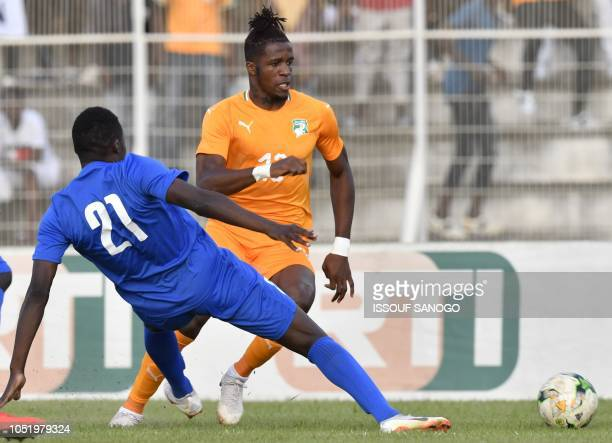 Ivory Coast's Wilfried Zaha vies with Central African Republic's Fernander Kassai during the African Cup of Nations CAN 2019 qualification football...