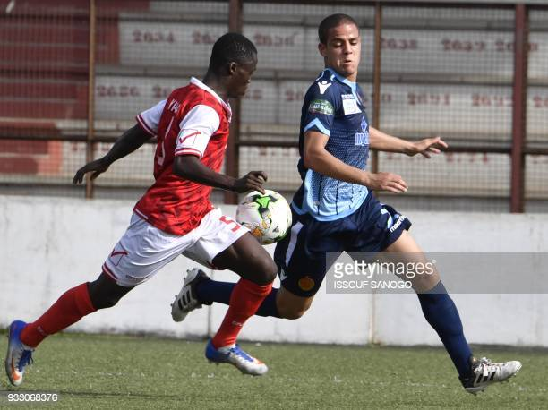 Ivory Coast's Yao Kouassi vies with Morocco's Rachid Housni during the CAF Champions league football match between Williamsville Athletic Club and...
