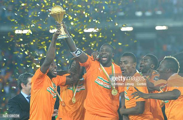 Ivory Coast's Yaya Toure holds up the trophy as he celebrates with his teammates after winning after the 2015 Orange Africa Cup of Nations Final...