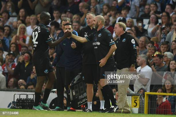 Ivory Coast's Yaya Toure is replaced by French former international Eric Cantona during an England V Soccer Aid World XI charity football match for...