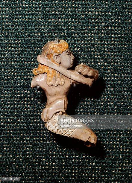 Ivory figure of Phoenician workmanship depicting a man fighting with a lion Phoenician Last third of 8th century Assyria Ancient Iraq
