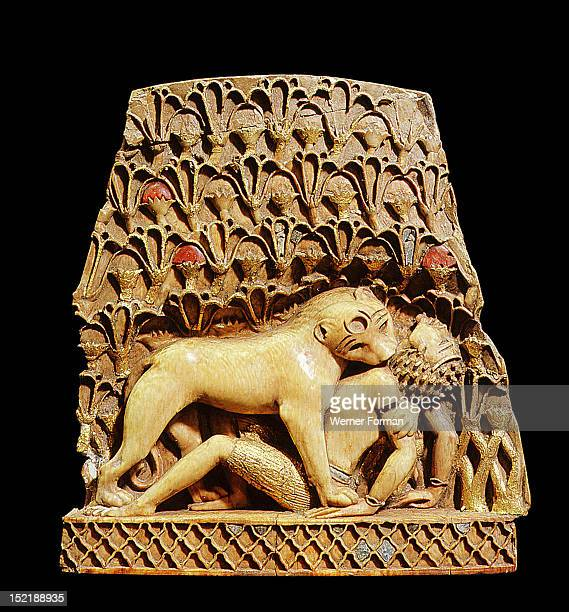Ivory inlay from Nimrud One of the two identical pieces of which one is in the British Museum and the other was in Iraq now missing A lioness springs...