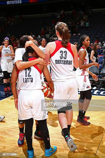Ivory Latta and Emma Meesseman of the Washington Mystics celebrate after the game against the Indiana Fever on September 8 2015 at the Verizon Center...