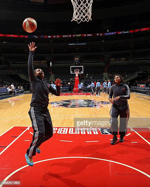 Ivory Latta and Tierra RuffinPratt of the Washington Mystics warm up before the game against the Atlanta Dream on September 13 2015 at the Verizon...