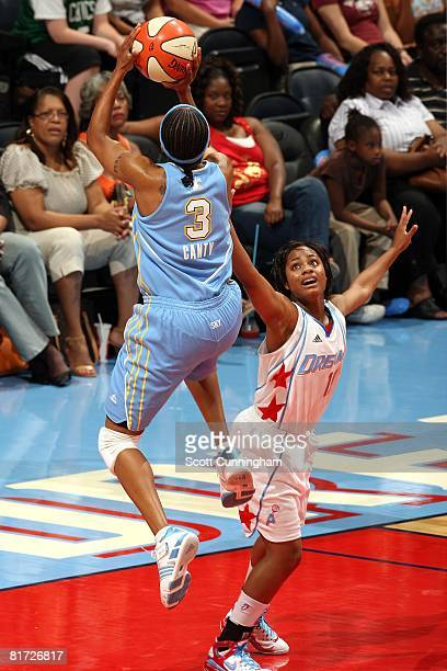 Ivory Latta of the Atlanta Dream challenges the shot by Dominique Canty of the Chicago Sky during the WNBA game on June 6 2008 at Philips Arena in...