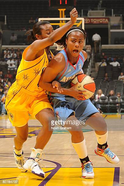 Ivory Latta of the Atlanta Dream drives on Shannon Bobbitt of the Los Angeles Sparks on September 11, 2008 at Staples Center in Los Angeles,...