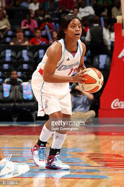 Ivory Latta of the Atlanta Dream looks to pass the ball against the Chicago Sky during the WNBA game on June 6 2008 at Philips Arena in Atlanta...