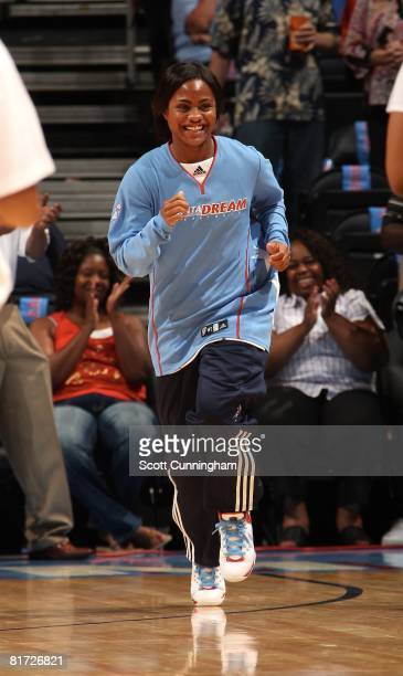 Ivory Latta of the Atlanta Dream runs onto the court during player introductions prior to the WNBA game against the Chicago Sky on June 6 2008 at...