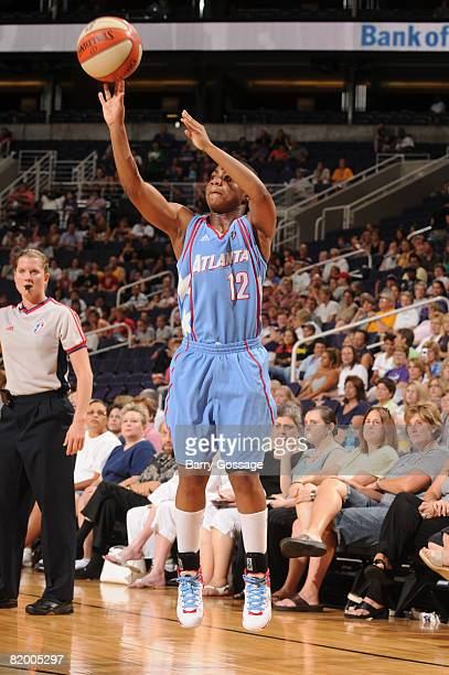Ivory Latta of the Atlanta Dream shoots against the Phoenix Mercury on July 19 at US Airways Center in Phoenix Arizona NOTE TO USER User expressly...