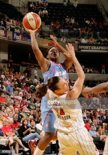 Ivory Latta of the Atlanta Dream shoots over Tully Bevilaqua of the Indiana Fever at Conseco Fieldhouse on August 30 2008 in Indianapolis Indiana The...