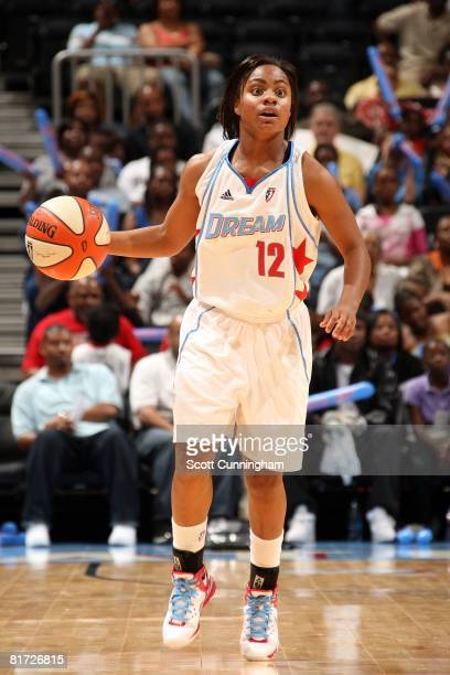 Ivory Latta of the Atlanta Dream surveys the floor against the Chicago Sky during the WNBA game on June 6 2008 at Philips Arena in Atlanta Georgia...