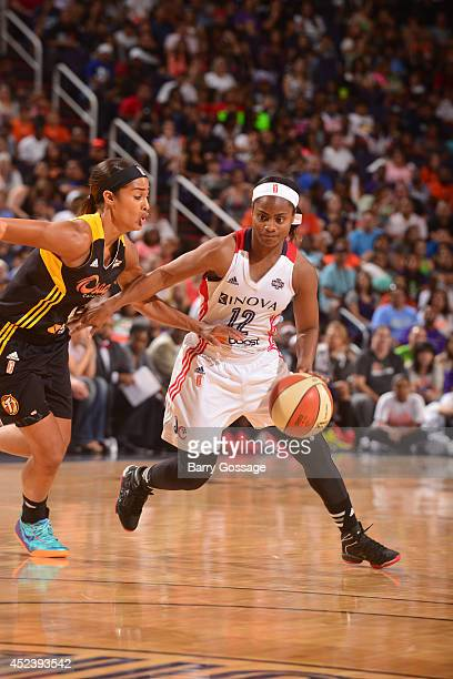 Ivory Latta of the Eastern Conference AllStars dribbles against Skylar Diggins of the Western Conference AllStars during the 2014 Boost Mobile WNBA...