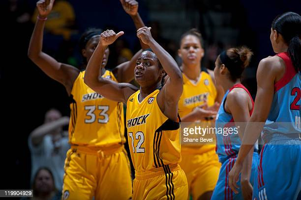Ivory Latta of the Tulsa Shock celebrates winning a jump ball during the WNBA game on July 26 2011 at the BOK Center in Tulsa Oklahoma NOTE TO USER...