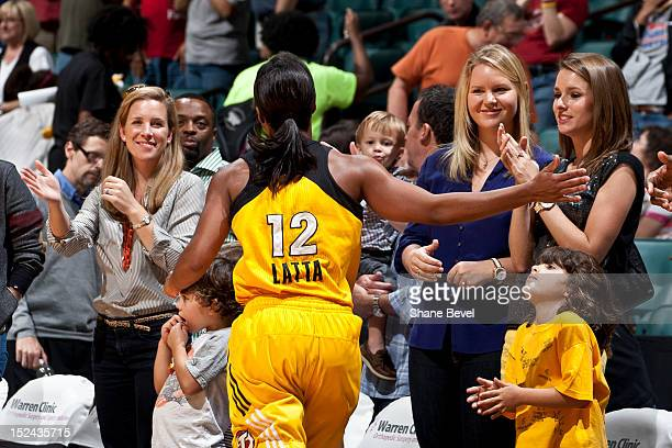Ivory Latta of the Tulsa Shock celebrates with fans and staff after the Shock won their last home game of the 2012 during the WNBA game on September...