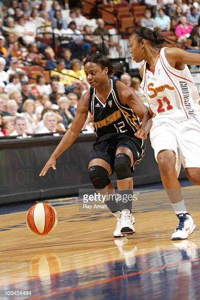 Ivory Latta of the Tulsa Shock dribbles against DeMaya Walker of the Connecticut Sun during the game on August 17 2010 at Mohegan Sun Arena in...