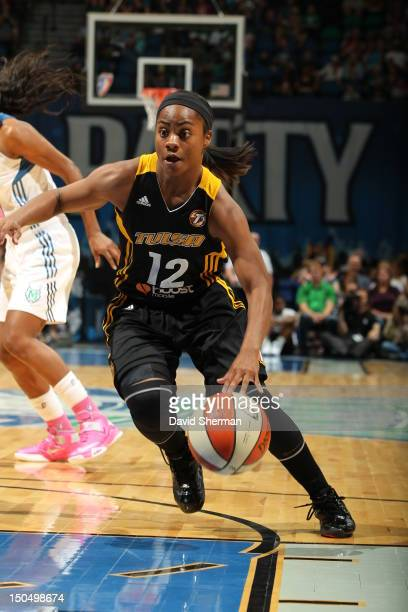 Ivory Latta of the Tulsa Shock dribbles the ball against the Minnesota Lynx during the WNBA game on August 19 2012 at Target Center in Minneapolis...