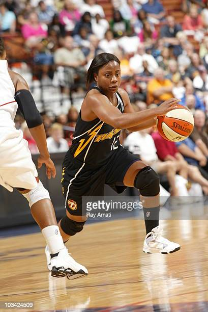 Ivory Latta of the Tulsa Shock drives against the Connecticut Sun during the game on August 17 2010 at Mohegan Sun Arena in Uncasville Connecticut...