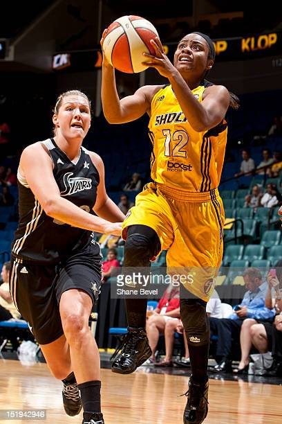 Ivory Latta of the Tulsa Shock drives to the basket against Jayne Appel of the San Antonio Silver Stars during the WNBA game on September 12 2012 at...