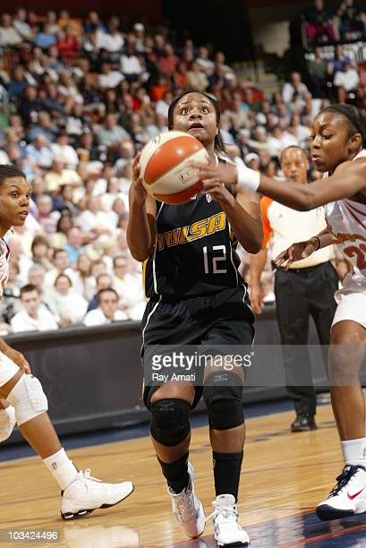 Ivory Latta of the Tulsa Shock eyes the basket against the Connecticut Sun during the game on August 17 2010 at Mohegan Sun Arena in Uncasville...