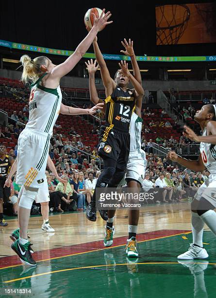 Ivory Latta of the Tulsa Shock goes to the basket against Lauren Jackson of the Seattle Storm during the game on September 6 2012 at Key Arena in...