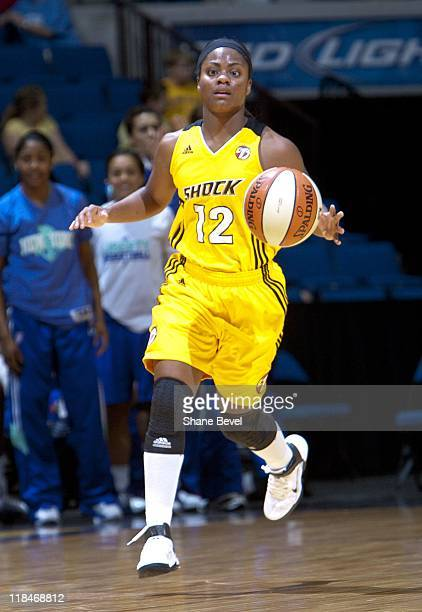 Ivory Latta of the Tulsa Shock handles the ball during the WNBA game against the New York Liberty on June 23 2011 at the BOK Center in Tulsa Oklahoma...