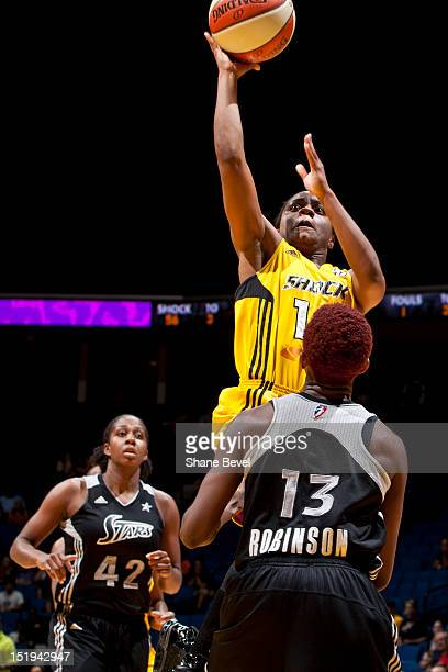 Ivory Latta of the Tulsa Shock shoots against Danielle Robinson of the San Antonio Silver Stars during the WNBA game on September 12 2012 at the BOK...