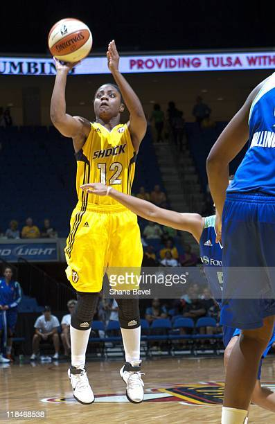 Ivory Latta of the Tulsa Shock shoots the ball during the WNBA game against the New York Liberty on June 23 2011 at the BOK Center in Tulsa Oklahoma...