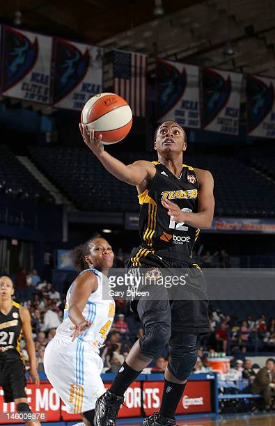 Ivory Latta of the Tulsa Shock takes the ball to the hoop during the WNBA game against the Chicago Sky on June 08 2012 at the AllState Arena in...