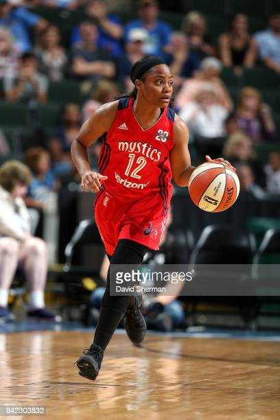 Ivory Latta of the Washington Mystics brings the ball up court during the game against the Minnesota Lynx on September 3 2017 at Xcel Energy Center...