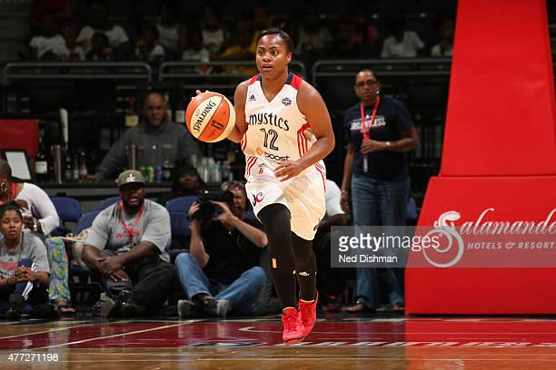 Ivory Latta of the Washington Mystics brings the ball up court against the Atlanta Dream in a WNBA game at the Verizon Center on June 12 2015 in...