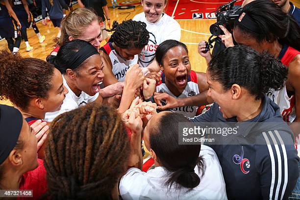 Ivory Latta of the Washington Mystics celebrates after the game against the Indiana Fever on September 8 2015 at the Verizon Center in Washington DC...