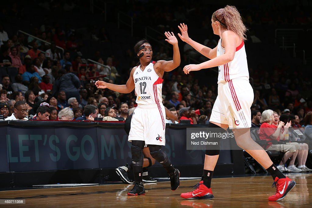 Ivory Latta #12 of the Washington Mystics celebrates with Stefanie Dolson #31 during the game against the New York Liberty at the Verizon Center on August 16, 2014 in Washington, DC.
