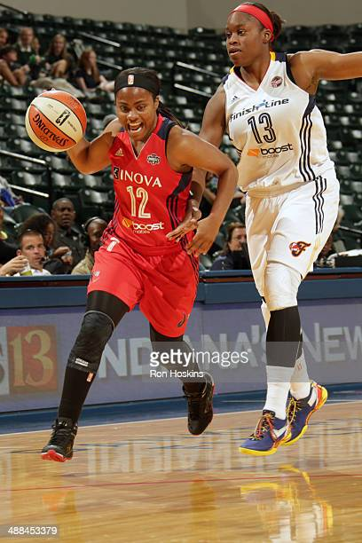 Ivory Latta of the Washington Mystics drives to the basket against Karima Christmas of the Indiana Fever during the WNBA preseason game on May 6 2014...