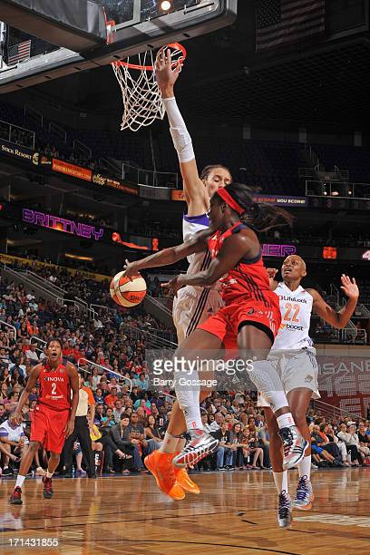 Ivory Latta of the Washington Mystics drives to the basket and passes the ball against the Phoenix Mercury on June 21 2013 at US Airways Center in...